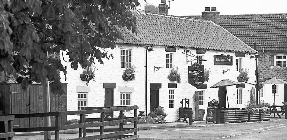 A historic photograph of The Freemasons Arms